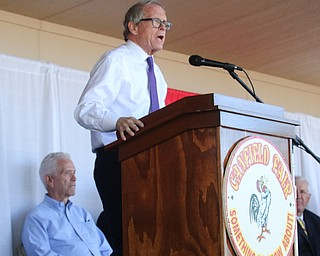 ROBERT K.YOSAY  | THE VINDICATOR..The 173rd version of the Canfield Fair official ribbon cutting as Fred Moran 84 jumped from the plane to help publicize Veterans Jobs.Mike DeWine talks about the Canfield Fair