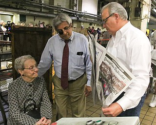 ROBERT K.YOSAY  | THE VINDICATOR..Publisher Betty Jagnow - editor Bertram DeSouza and General Manager Mark A Brown... look over the final edition after 150 years of publications
