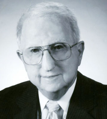 JAMES E. FOX