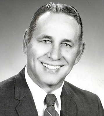 NORMAN B. PURUCKER
