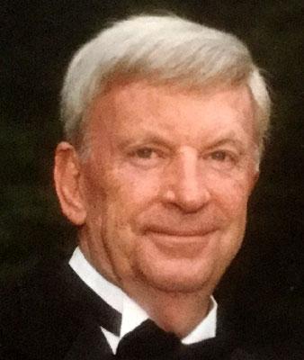 JAMES E. MAUGHAN