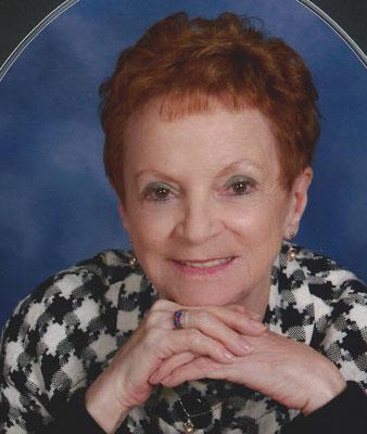 JUANITA E. MILLER