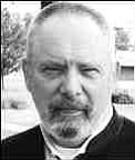 ROBERT M. GAUT