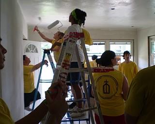 Painting the livingroom ceiling.
