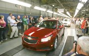 It was a moment for celebration at the Lordstown General Motors Complex here Wednesday, when the company kicked off official production of the 2011 Chevrolet Cruze