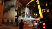 Demolition of the historic Paramount Theater in Youngstown is going on during the night.